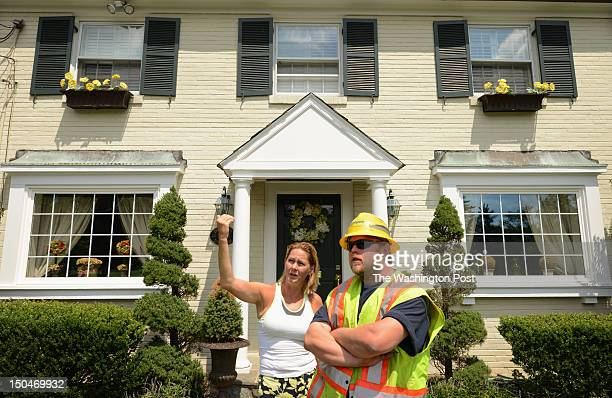 Pepco employee Jacob DuBose talks to Elizabeth Leary as he responds to a downed power line call on Monday August 13 2012 in Chevy Chase MD Pepco has...