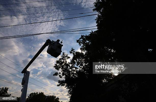 Pepco employee James Tarantella works on fixing a blown fuse on a power outage call on Monday August 13 2012 in Rockville MD Pepco has been...