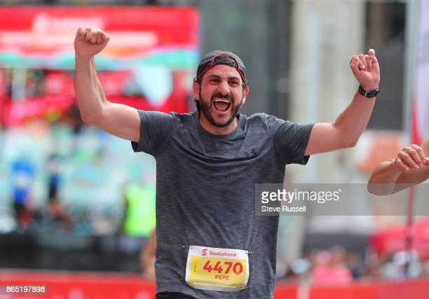 TORONTO ON OCTOBER 22 Pepe Ambe of Mexico crosses the finish line during the Scotiabank Toronto Waterfront Marathon in Toronto October 22 2017