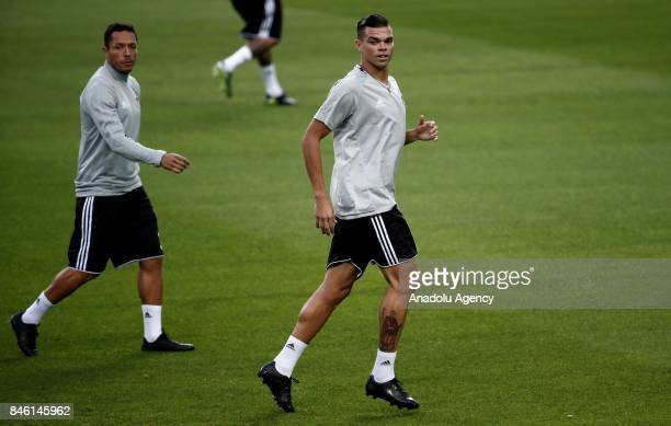 Pepe and Adriano of Besiktas attend a training session ahead of UEFA Champions League Group G match between Porto and Besiktas at Dragon Stadium in...
