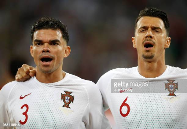Pepe and Jose Fonte of Portugal sing their national anthem ahead of the 2018 FIFA World Cup Russia Round of 16 match between Uruguay and Portugal at...