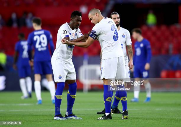 Pepe and Zaidu Sanusi of Porto interact prior to the UEFA Champions League Quarter Final Second Leg match between Chelsea FC and FC Porto at Estadio...