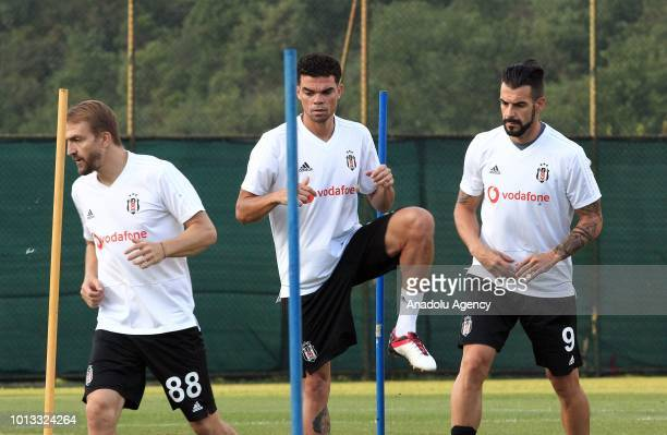 Pepe Caner Erkin and Alvaro Negredo of Besiktas attend a training session ahead of the UEFA Europa League 3rd Qualifying Round first leg match...