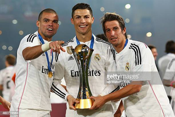 Pepe, Cristiano Ronaldo and Fabio Coentrao of Real Madrid celebrate with the trophy after the FIFA Club World Cup Final between Real Madrid and San...