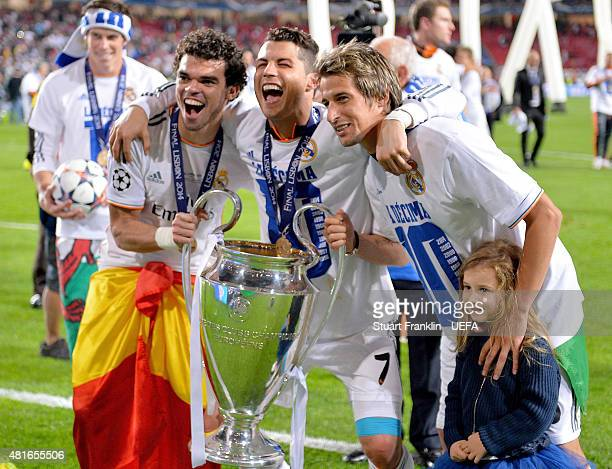 Pepe Cristiano Ronaldo and Fabio Coentrao of Real Madrid celebrate with the trophy following their team's victory during the UEFA Champions League...