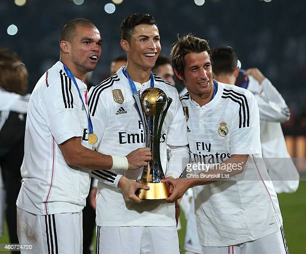 Pepe Cristiano Ronaldo and Fabio Coentrao of Real Madrid pose with the trophy following the FIFA Club World Cup Final match between Real Madrid CF...