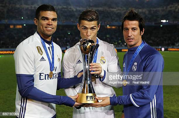 Pepe, Cristiano Ronaldo and Fabio Coentrao of Real Madrid pose with the trophy after the FIFA Club World Cup Final match between Real Madrid and...