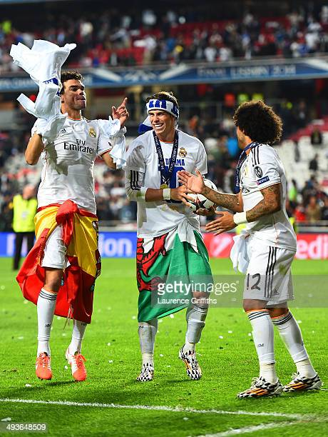 Pepe Gareth Bale and Marcelo of Real Madrid celebrate victory after the UEFA Champions League Final between Real Madrid and Atletico de Madrid at...