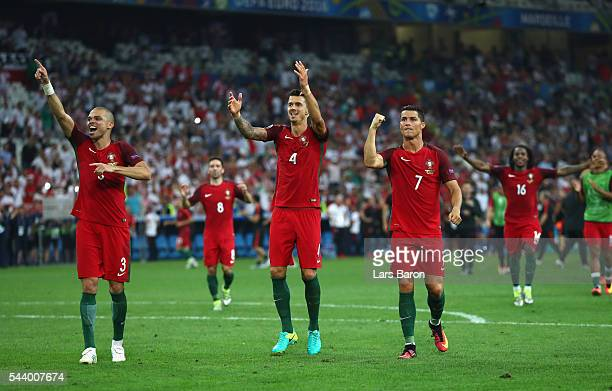 Pepe Jose Fonte and Cristiano Ronaldo of Portugal celebrate their team's win after the UEFA EURO 2016 quarter final match between Poland and Portugal...