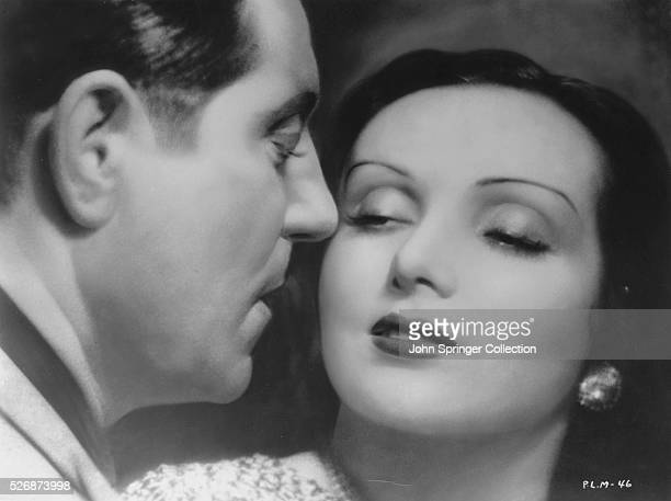 Pepe le Moko gets close to Gaby Gould in this romantic scene from the 1937 French film Pepe le Moko
