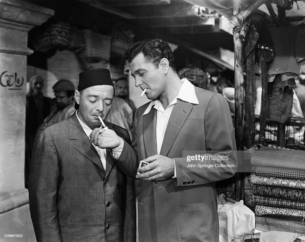 pepe le moko lights a cigarette for slimane in a scene from the film news photo getty images. Black Bedroom Furniture Sets. Home Design Ideas