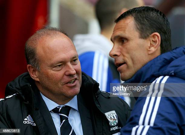 Pepe Mel manager of West Bromwich Albion and Gus Poyet manager of Sunderland in discussion prior to the Barclays Premier League match between...
