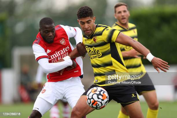 Pepe of Arsenal and Adam Masina of Watford during the Pre-Season Friendly between Arsenal and Watford at London Colney on July 28, 2021 in St Albans,...