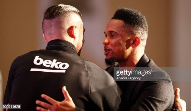 Pepe of Besiktas and Samuel Eto'o of Antalyaspor chat each other as they participate in a panel titled 'Turkish and European Coach Regard as Football...