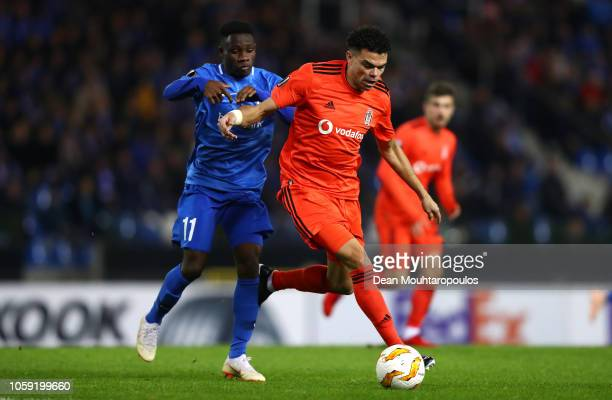 Pepe of Besiktas evades Joseph Paintsil of KRC Genk during the UEFA Europa League Group I match between KRC Genk and Besiktas at Cristal Arena on...