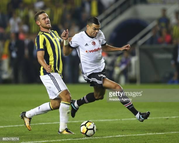 Pepe of Besiktas in action against Janssen of Fenerbahce during the Turkish Super Lig week 6 soccer match against Besiktas at Ulker Stadium in...
