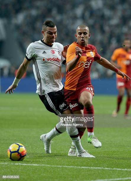Pepe of Besiktas vies with Feghouli of Galatasaray during the Turkish Super Lig match between Besiktas and Galatasaray at Vodafone Park in Istanbul...
