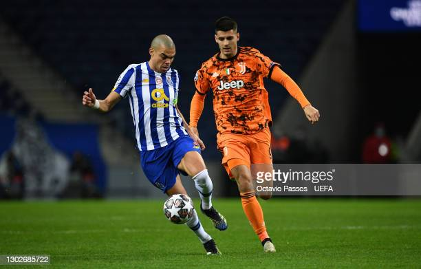 Pepe of FC Porto controls the ball whilst under pressure from Alvaro Morata of Juventus during the UEFA Champions League Round of 16 match between FC...