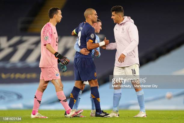 Pepe of FC Porto embraces Phil Foden of Manchester City following the UEFA Champions League Group C stage match between Manchester City and FC Porto...