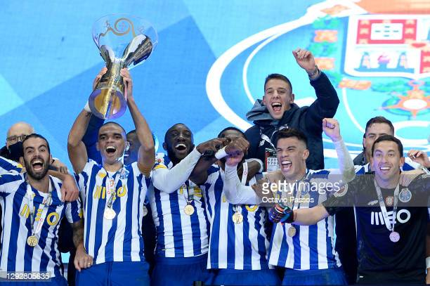 Pepe of FC Porto lifts the Candido de Oliveira trophy with teammates following victory in the Portuguese Super Cup final between FC Porto and SL...