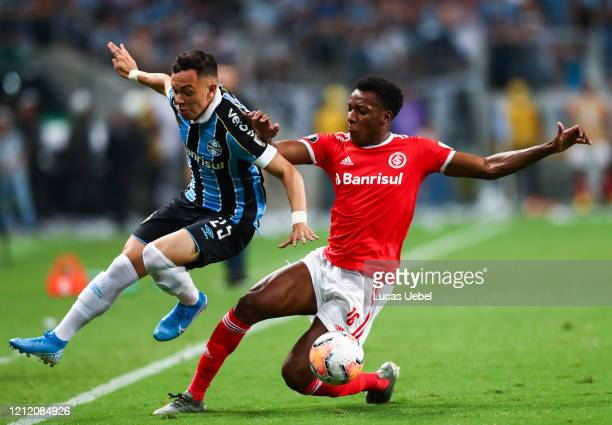 Pepe of Gremio and Moises of Internacional fight for the ball during the match between Gremio and Internacional for the Copa CONMEBOL Libertadores...