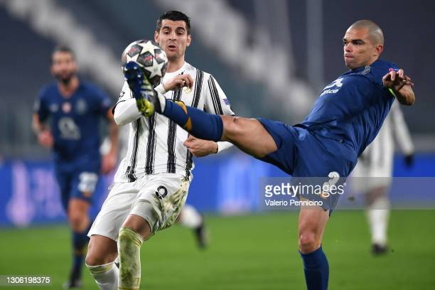 Pepe of Porto attempts to clear the ball whilst under pressure from Alvaro Morata of Juventus during the UEFA Champions League Round of 16 match...