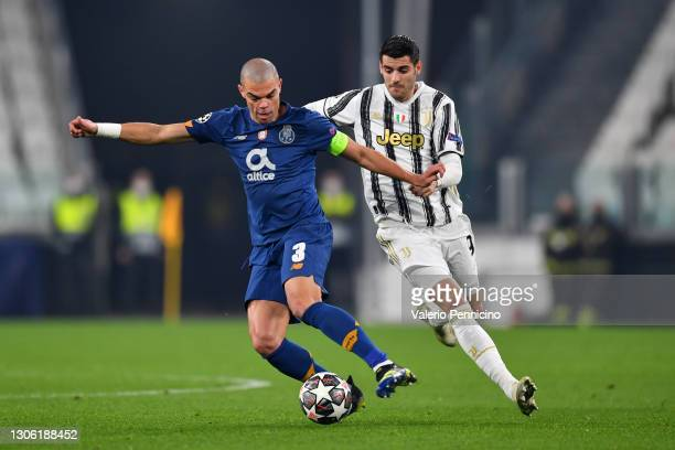 Pepe of Porto battles for possession with Alvaro Morata of Juventus during the UEFA Champions League Round of 16 match between Juventus and FC Porto...