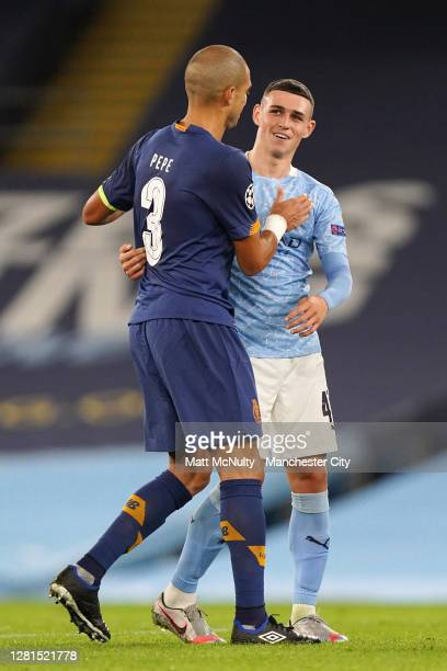 Pepe of Porto with Phil Foden of Manchester City during the UEFA Champions League Group C stage match between Manchester City and FC Porto at Etihad...