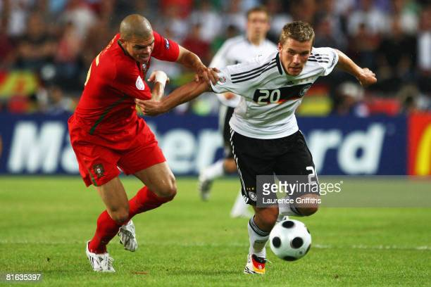 Pepe of Portugal and Lukas Podolski of Germany battle for the ball during the UEFA EURO 2008 Quarter Final match between Portugal and Germany at St....