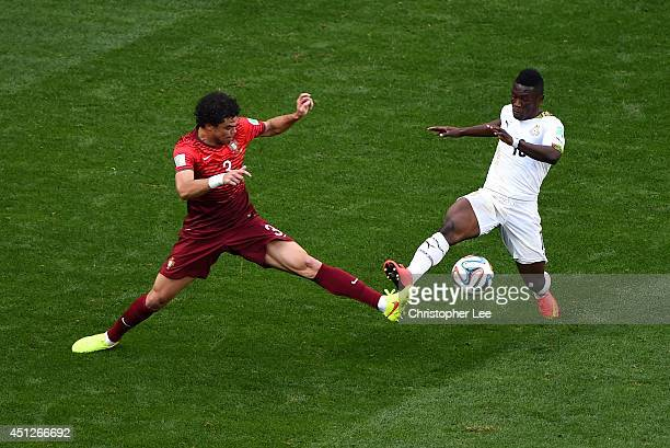 Pepe of Portugal and Majeed Waris of Ghana compete for the ball during the 2014 FIFA World Cup Brazil Group G match between Portugal and Ghana at...