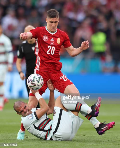 Pepe of Portugal battles for possession with Roland Sallai of Hungary during the UEFA Euro 2020 Championship Group F match between Hungary and...
