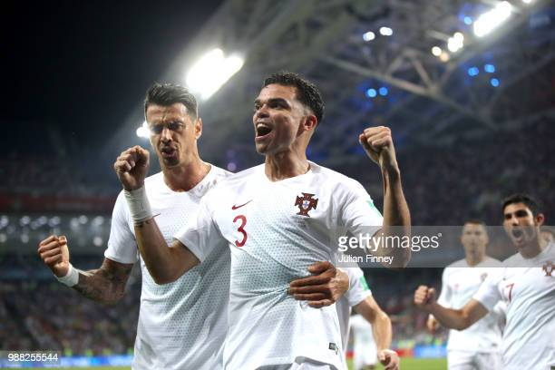 Pepe of Portugal celebrates after scoring his team's first goal with team mate Jose Fonte during the 2018 FIFA World Cup Russia Round of 16 match...