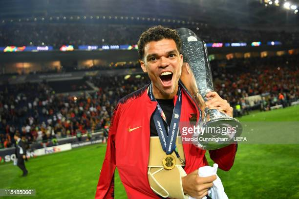 Pepe of Portugal celebrates with the UEFA Nations League Trophy following his team's victory in the UEFA Nations League Final between Portugal and...