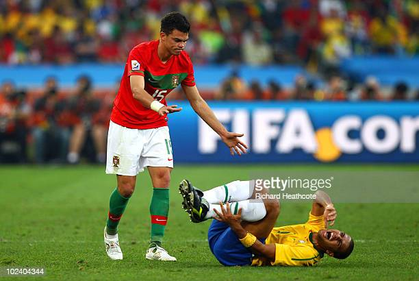 Pepe of Portugal checks that Julio Baptista of Brazil is alright following a challenge during the 2010 FIFA World Cup South Africa Group G match...
