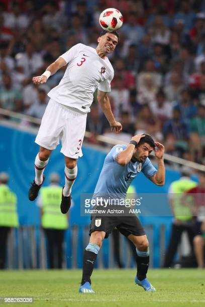 Pepe of Portugal competes with Luis Suarez of Uruguay during the 2018 FIFA World Cup Russia Round of 16 match between Uruguay and Portugal at Fisht...