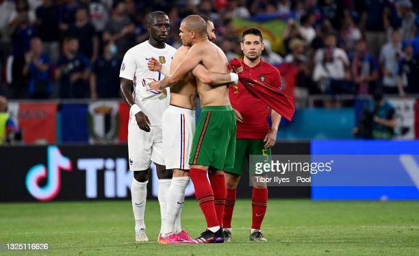 Pepe of Portugal embraces Karim Benzema of France after they swapped shirts following the UEFA Euro 2020 Championship Group F match between Portugal...