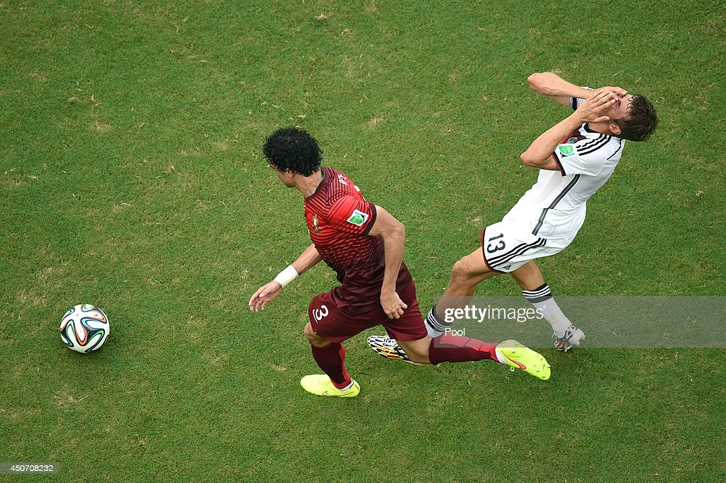 Pepe of Portugal fouls Thomas Mueller of Germany during the 2014 FIFA World Cup Brazil Group G match between Germany and Portugal at Arena Fonte Nova on June 16, 2014 in Salvador, Brazil.