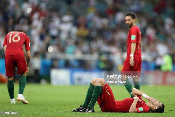 Pepe of Portugal goes down injured moments before Diego Costa of Spain scores Spain's first goal during the 2018 FIFA World Cup Russia group B match...