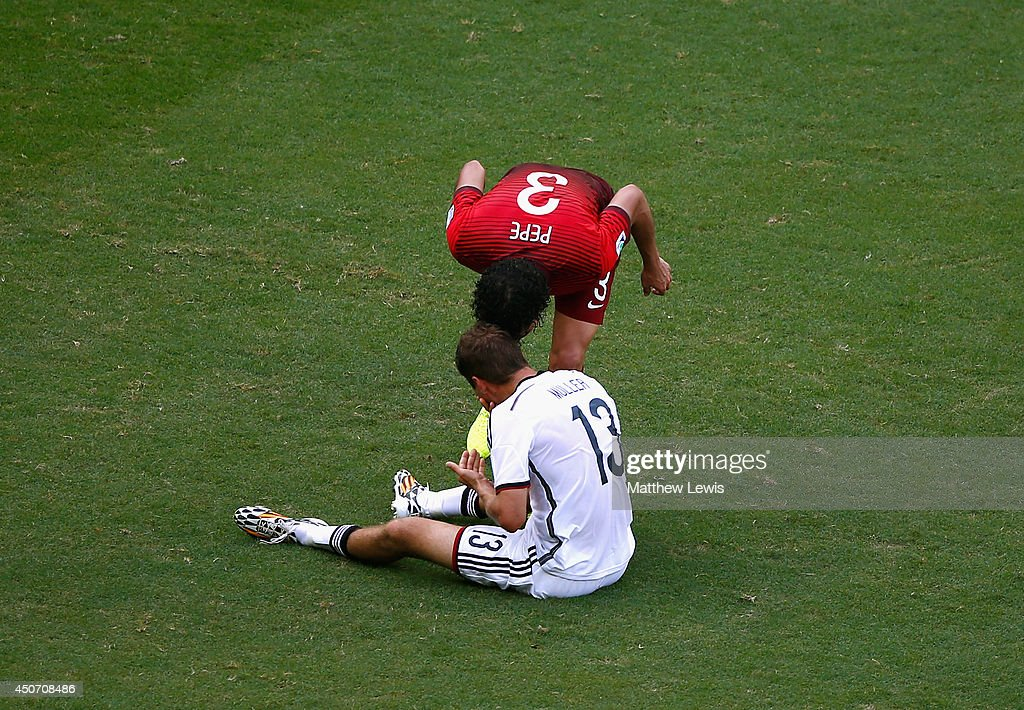 Pepe of Portugal headbutts Thomas Mueller of Germany resulting in a red card during the 2014 FIFA World Cup Brazil Group G match between Germany and Portugal at Arena Fonte Nova on June 16, 2014 in Salvador, Brazil.
