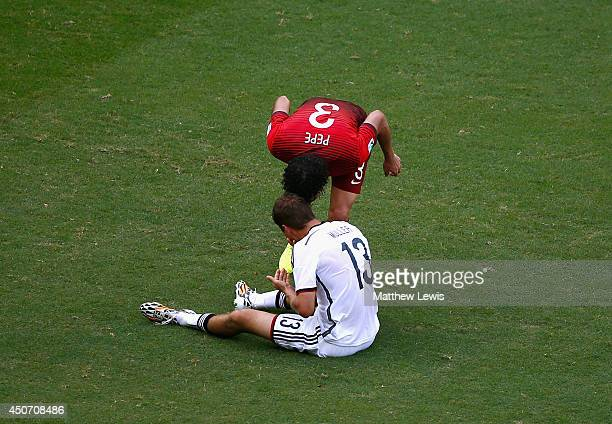 Pepe of Portugal headbutts Thomas Mueller of Germany resulting in a red card during the 2014 FIFA World Cup Brazil Group G match between Germany and...