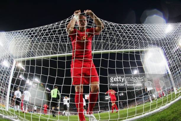 Pepe of Portugal holds the net after a missed chance during the UEFA EURO 2008 Quarter Final match between Portugal and Germany at St. Jakob-Park on...