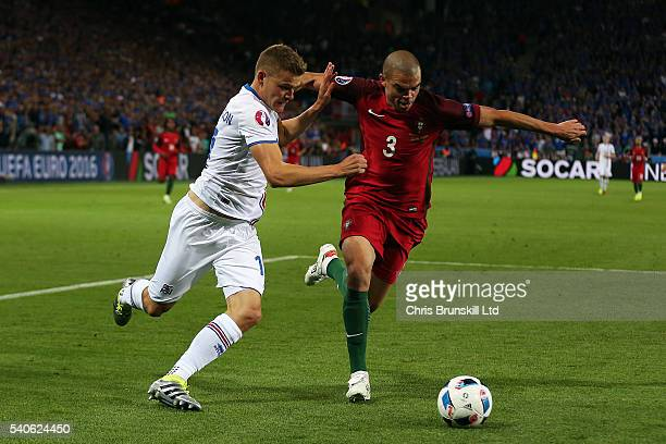 Pepe of Portugal in action with Alfred Finnbogason of Iceland during the UEFA Euro 2016 Group F match between Portugal and Iceland at Stade...