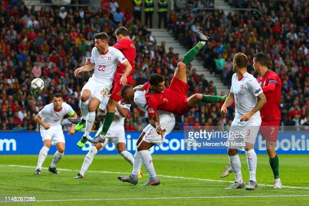 Pepe of Portugal injures himself after this collision with Manuel Akanji of Switzerland and has to go off during the UEFA Nations League SemiFinal...