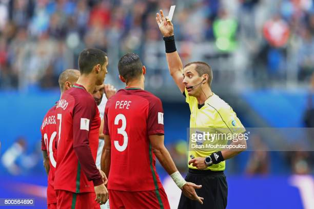 Pepe of Portugal is shown a yellow card by Referee Mark Geiger during the FIFA Confederations Cup Russia 2017 Group A match between New Zealand and...