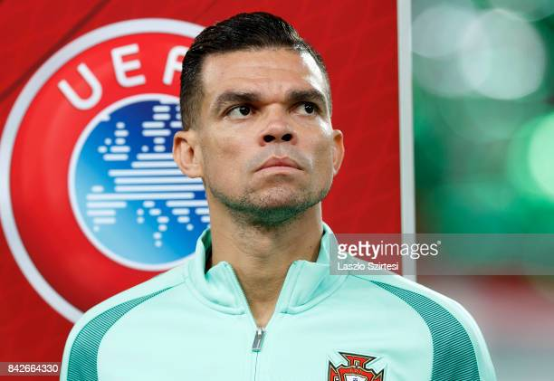 Pepe of Portugal listens to the anthems prior to the FIFA 2018 World Cup Qualifier match between Hungary and Portugal at Groupama Arena on September...