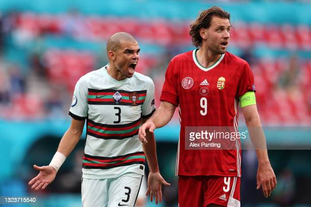 Pepe of Portugal reacts next to Adam Szalai of Hungary during the UEFA Euro 2020 Championship Group F match between Hungary and Portugal at Puskas...