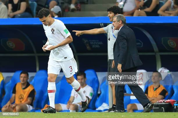 Pepe of Portugal returns to the pitch holding notes from Portugal coach Fernando Santos during the 2018 FIFA World Cup Russia Round of 16 match...