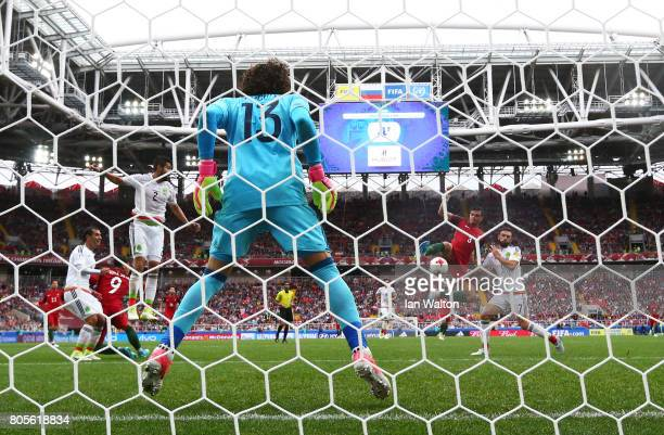 Pepe of Portugal scores his sides first goal past Guillermo Ochoa of Mexico during the FIFA Confederations Cup Russia 2017 PlayOff for Third Place...