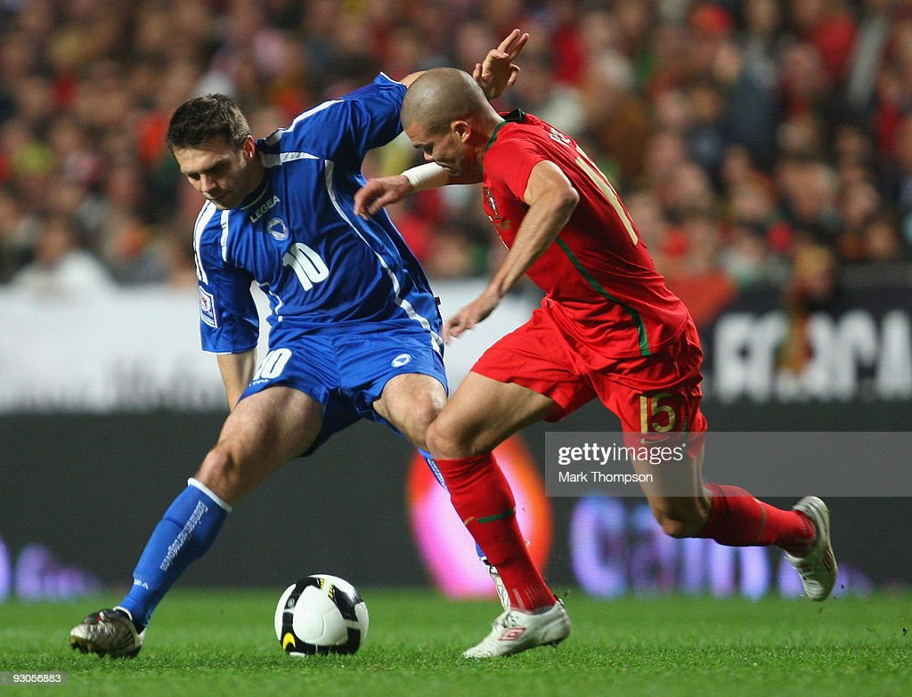 Pepe of Portugal tangles with Zvjezdan Msimovic of Bosnia during the FIFA 2010 European World Cup qualifier first leg match between Portugal and Bosnia-Herzegovina at the Luz stadium on November 14, 2009 in Lisbon, Portugal.