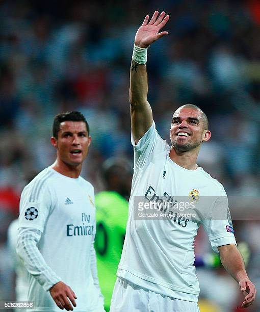 Pepe of Real Madrid and Cristiano Ronaldo of Real Madrid celebrate victory during the UEFA Champions League semi final second leg match between Real...